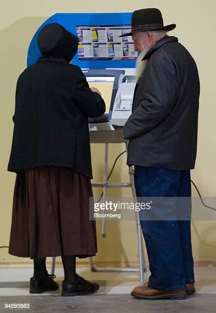 An Amish couple uses an electronic voting machine to cast their ballots in Charm Ohio Tuesday November 7 2006 This was the first election in Ohio...