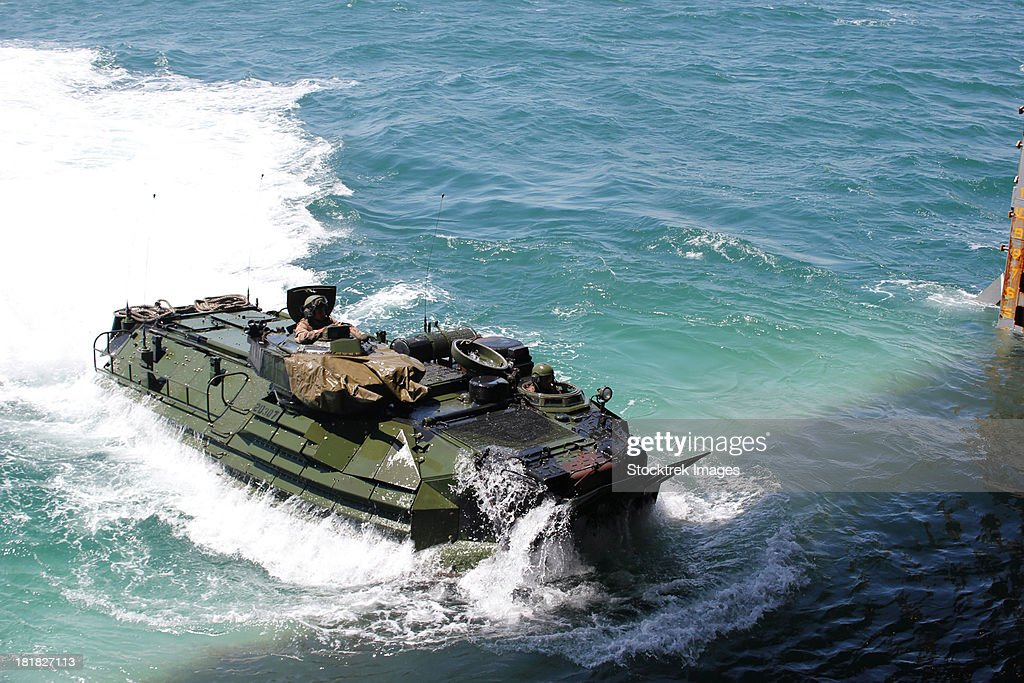 An amphibious assault vehicle approaches the well deck of USS Fort McHenry.