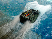 Mediterranean Sea, October 10, 2009 - An amphibious assault vehicle (AAV) exits the well deck of the amphibious dock landing ship USS Fort McHenry (LSD-43) during the multinational exercise Bright Sta