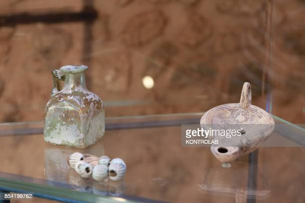 An ampoule an oil lamp and a bracelet are displayed in an exibition hall in the Championnet Villa reopened after restoration in the archaeological...