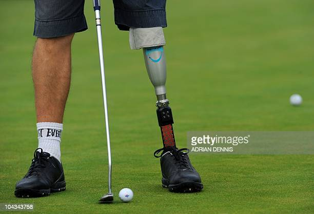 An amputee golfer practices on the putting green ahead of the second day of the Disabled British Open golf tournament at East Sussex National golf...