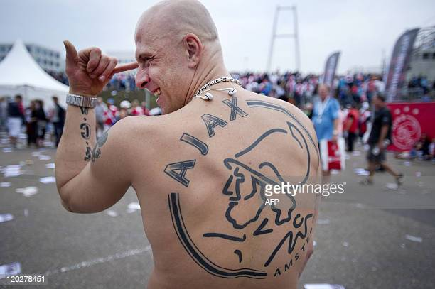 An Amsterdam Ajax football fan shows off his tattoo at Amsterdam Arena on August 3 the football club's opening day AFP PHOTO / ANP / OLAF KRAAK...