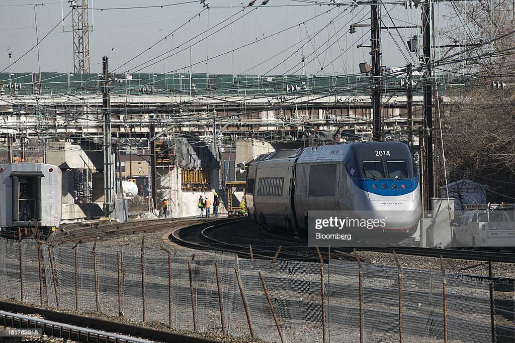 An Amtrak Acela passenger train departs Union Station in Washington, D.C., U.S., on Friday, Feb. 15, 2013. Amtrak, the U.S. long-distance passenger railroad and federally subsidized since its beginning 41 years ago, last month reported its lowest operating loss in nearly four decades, announcing the passenger rail company had reduced its total operating loss by 19 percent compared to the previous year. Photographer: Andrew Harrer/Bloomberg via Getty Images