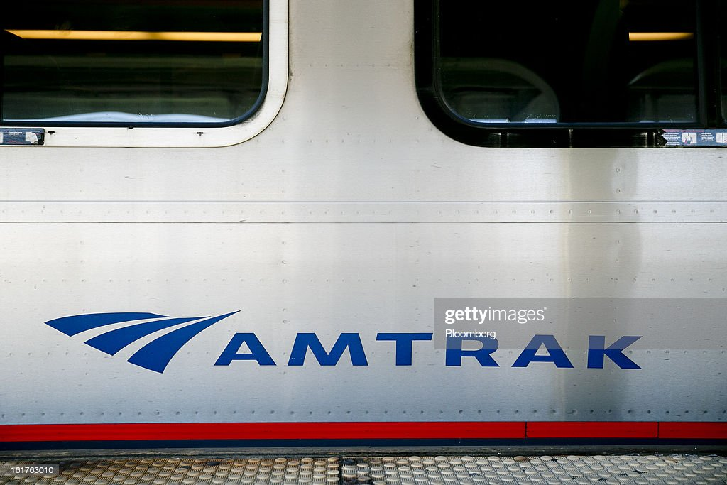 An Amtrak Acela passenger train sits at Union Station in Washington, D.C., U.S., on Friday, Feb. 15, 2013. Amtrak, the U.S. long-distance passenger railroad and federally subsidized since its beginning 41 years ago, last month reported its lowest operating loss in nearly four decades, announcing the passenger rail company had reduced its total operating loss by 19 percent compared to the previous year. Photographer: Andrew Harrer/Bloomberg via Getty Images