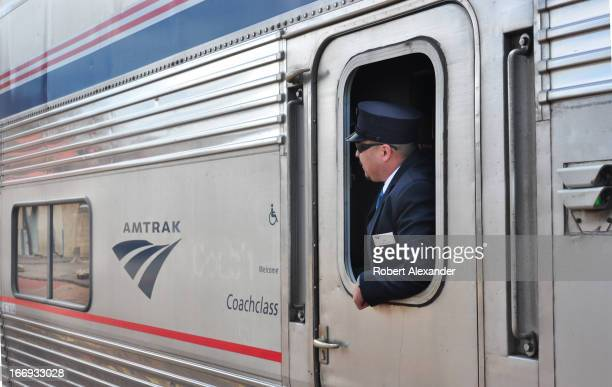 An Amtrak conductor looks out a window as the Southwest Chief prepares to leave the Amtrak station in Lamy New Mexico The train runs daily between...