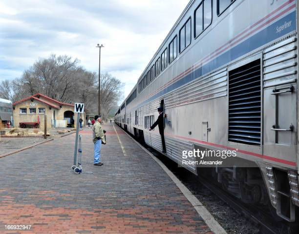 An Amtrak conductor signals the engineer as the Southwest Chief prepares to leave the Amtrak station in Lamy New Mexico The train runs daily between...