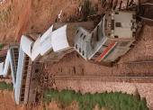 An Amtrak passenger train lies derailed 13 miles East of Kingman Arizona 09 August after a passing over a railroad bridge that was apparently damaged...