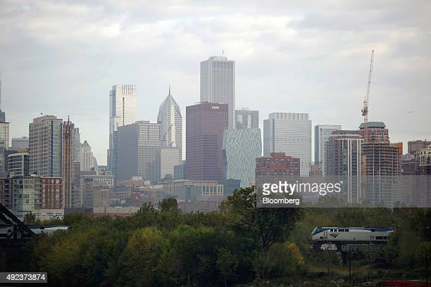 An Amtrak passenger train travels past the skyline of Chicago Illinois US on Wednesday Oct 7 2015 The head of Amtrak warned Congress that some...