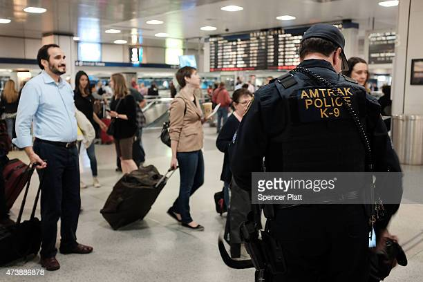 An Amtrak police officer and his dog keep guard as normal service returned between New York City and Philadelphia on May 18 2015 in New York City...