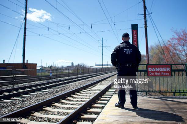 An Amtrak police officer monitors activity at the Highland Avenue train station near the crash of Amtrak Palmetto train 89 on April 3 2016 in Chester...