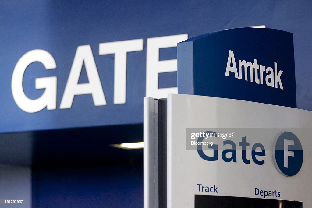 An Amtrak sign reads 'Gate F' at Union Station in Washington, D.C., U.S., on Friday, Feb. 15, 2013. Amtrak, the U.S. long-distance passenger railroad and federally subsidized since its beginning 41 years ago, last month reported its lowest operating loss in nearly four decades, announcing the passenger rail company had reduced its total operating loss by 19 percent compared to the previous year. Photographer: Andrew Harrer/Bloomberg via Getty Images