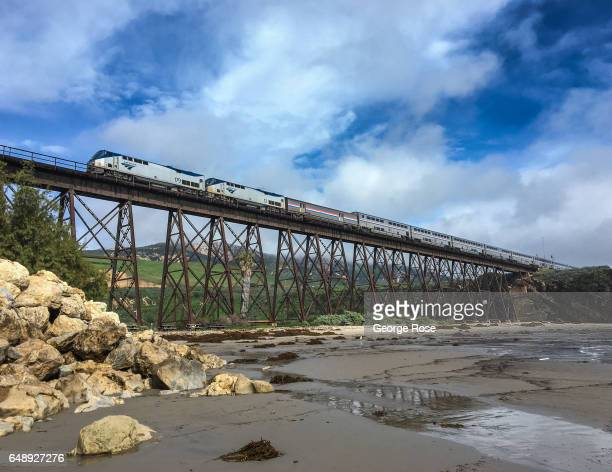 An Amtrak Surfliner train passes over the beach on a steel trestle bridge as viewed on January 8 in Gaviota State Park California Because of its...