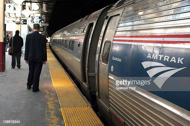 An Amtrak train waits in Newark Penn Station on February 8 2011 in Newark New Jersey Amtrak a governmentowned corporation has joined up with New...