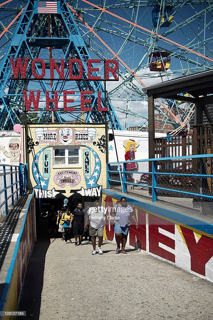 An amusement arcade and ferris wheel in Coney Island on a summers day on August 23, 2011 in New York. New York City, a financial, cultural and tourism centre, has the largest population of any city in the United States.
