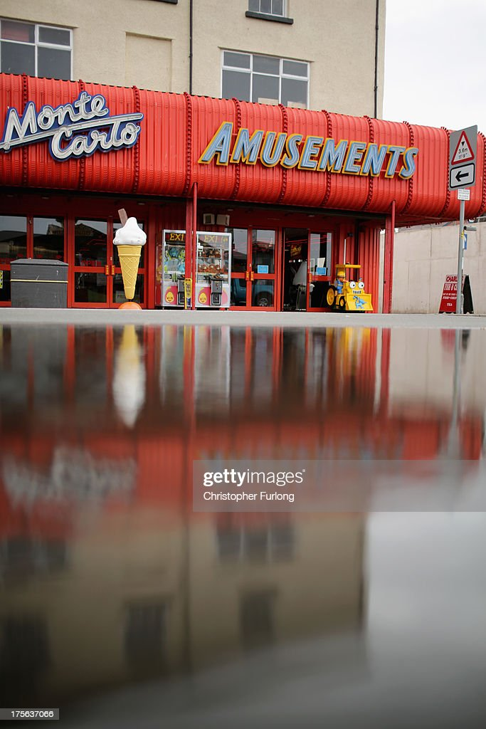 An amusement arcade is reflected in a puddle on August 5, 2013 in Rhyl, Wales. The think tank The Centre for Social Justice (CSJ) has today said that some British seaside towns such as Rhyl in North Wales were becoming 'dumping grounds' for vulnerable people. The report 'Turning the Tide' has monitored conditions in five seaside towns, Rhyl in Denbighshire, Margate in Kent, Clacton-on-Sea in Essex, Blackpool in Lancashire and Great Yarmouth in Norfolk. In one area of Rhyl, over 66% of working-age people were found to be dependent on out-of-work benefits.