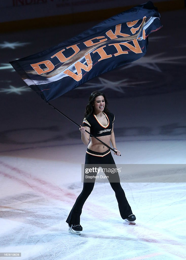 An Anaheim Ducks ice girl waves a 'Ducks Win' banner after the game against the Nashville Predators at Honda Center on February 27, 2013 in Anaheim, California. The Ducks won 5-1.