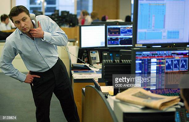 An analyst speaks on the phone while working on the trading floor at Goldman Sachs in London 22 March 2004 AFP PHOTO / ODD ANDERSEN
