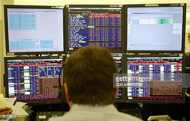 An analyst works on the trading floor at Goldman Sachs in London 22 March 2004 AFP PHOTO / ODD ANDERSEN