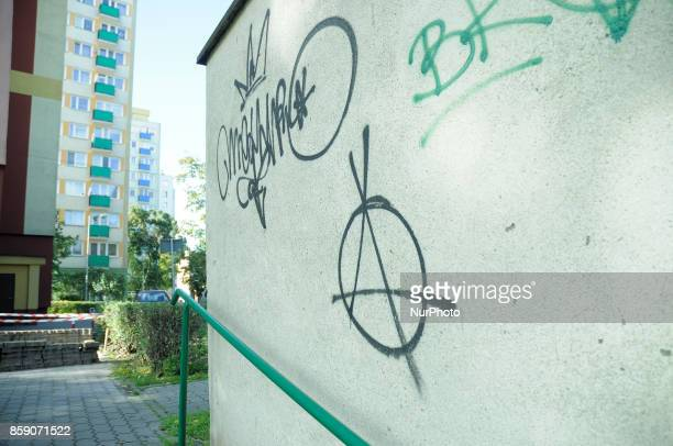 An anarchy logo is seen spray painted on a wall in a residential neighbourhood on October 8 2017 in Bydgoszcz Poland