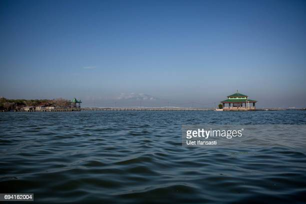 An ancestral graves is seen sits surrounded by rising sea levels at Sriwulan village on June 8 2017 in Demak Indonesia Indonesia is known to be one...