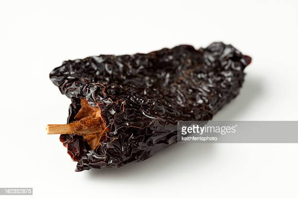 An ancho chili on a white background