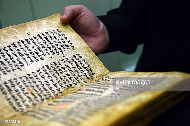An ancient book dated 1481 is displayed in the library of the Vatican's Gregorian University on November 14 2012 in Rome The Jesuit university...