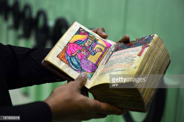 An ancient Ethiopian book is displayed in the library of the Vatican's Gregorian University on November 14 2012 in Rome The Jesuit university founded...