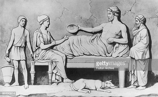 An ancient Greek man eats dinner with his family in the traditional reclining position circa 500 BC Taken from a bas relief sculpture