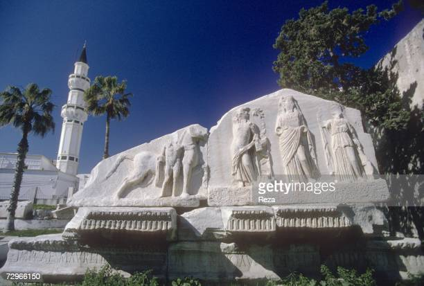 An ancient Roman pediment carved in elaborate basrelief remains in the oldest section of Tripoli May 2000 in Tripoli Libya