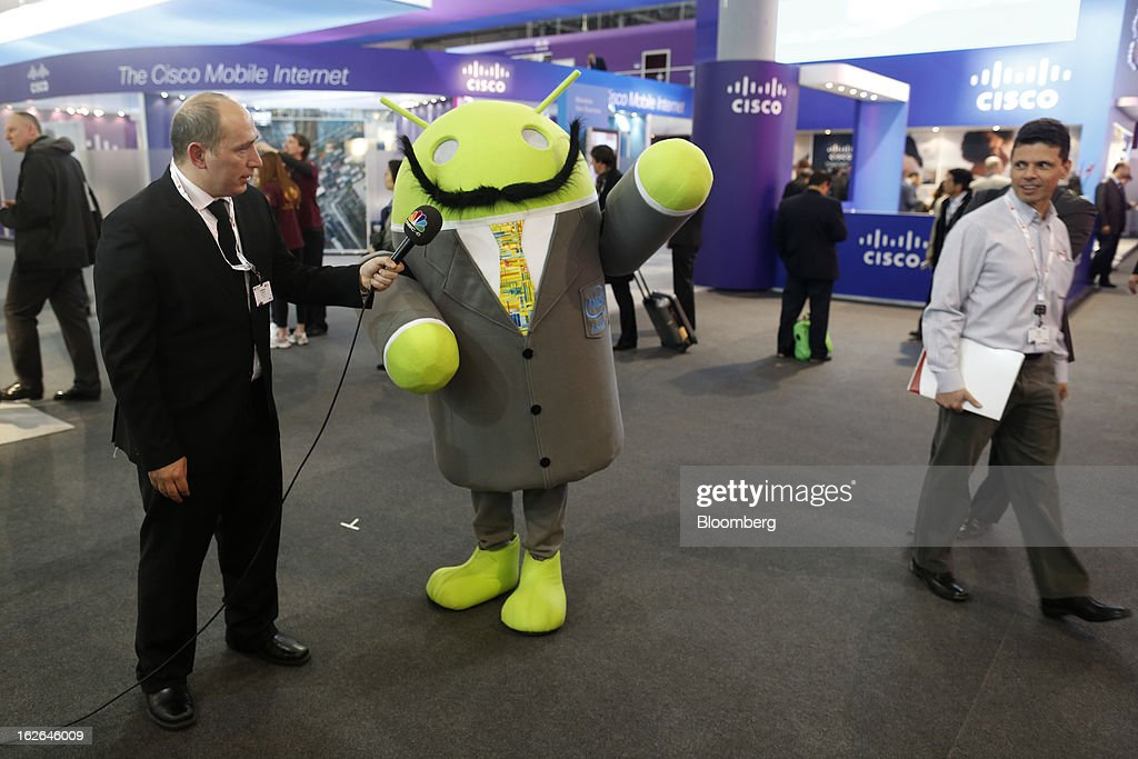 An Android character promoting the Android operating system is interviewed in a hall at the Mobile World Congress in Barcelona, Spain, on Monday, Feb. 25, 2013. The Mobile World Congress, where 1,500 exhibitors converge to discuss the future of wireless communication, is a global showcase for the mobile technology industry and runs from Feb. 25 through Feb. 28. Photographer: Simon Dawson/Bloomberg via Getty Images