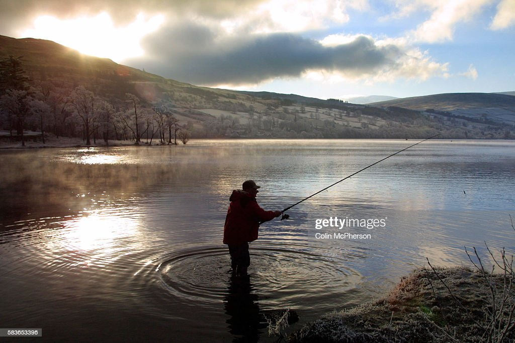 An angler casts into the waters of the River Tay at Kenmore the location for the traditional start to the salmon and trout fishing season in Scotland...