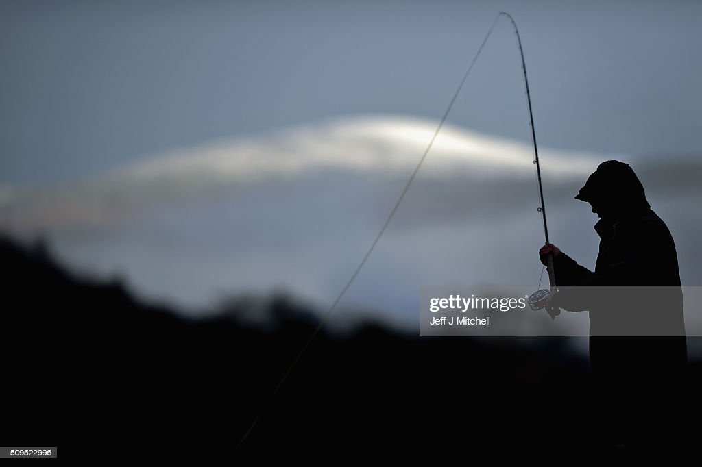 An angler fishes during the opening day of the salmon season on the River Spey on February 11, 2016 in Aberlour, Scotland. The annual opening day ceremony took place at Penny Bridge, with the traditional pouring of a bottle of Aberlour twelve year old single malt Scotch whisky into the river.