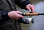 An anglers prepares his gear and tackle during the Traditional opening of the Tay Salmon Season on the River Tay on January 15 2014 in Kenmore...