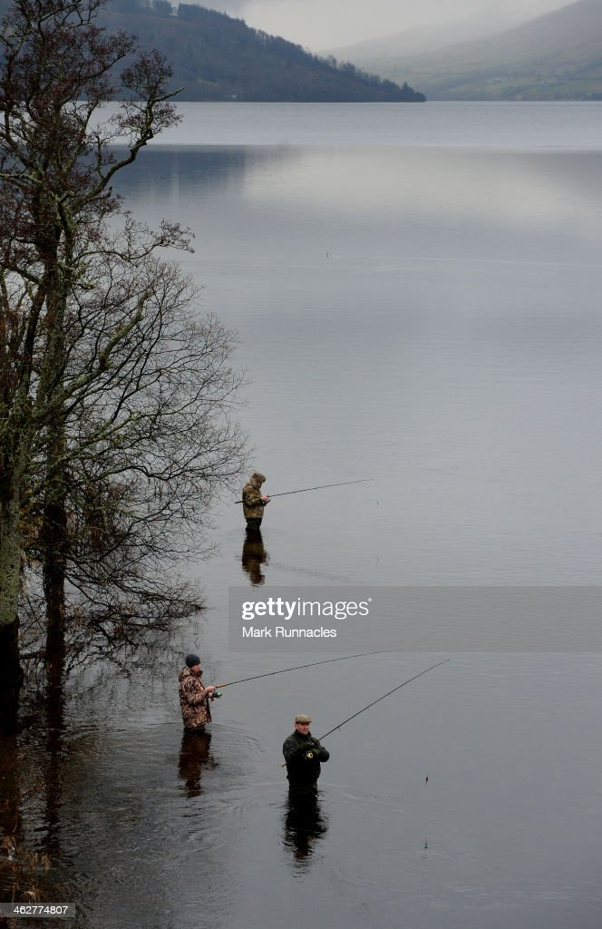 An Anglers work in the water on the banks of the River Tay during the Traditional opening of the Tay Salmon Season on the River Tay on January 15, 2014 in Kenmore Scotland. Today marks the start of the 2014 salmon season, the River Tay is famous for its salmon fishing and the traditional opening has been taking place since 1947.