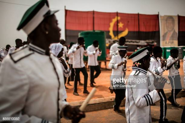 An Angolan marching band from the 'Church of Jesus Christ on Earth by His special envoy Simon Kimbangu' marches past an Angolan flag during an...