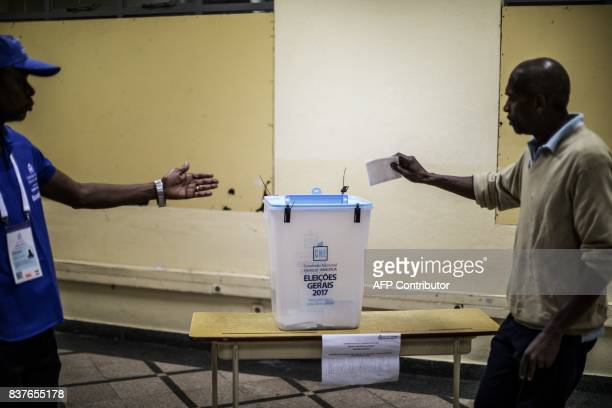 TOPSHOT An Angolan voter prepares to cast his ballot at a polling station in Luanda on August 23 2017 during general elections Polling stations...
