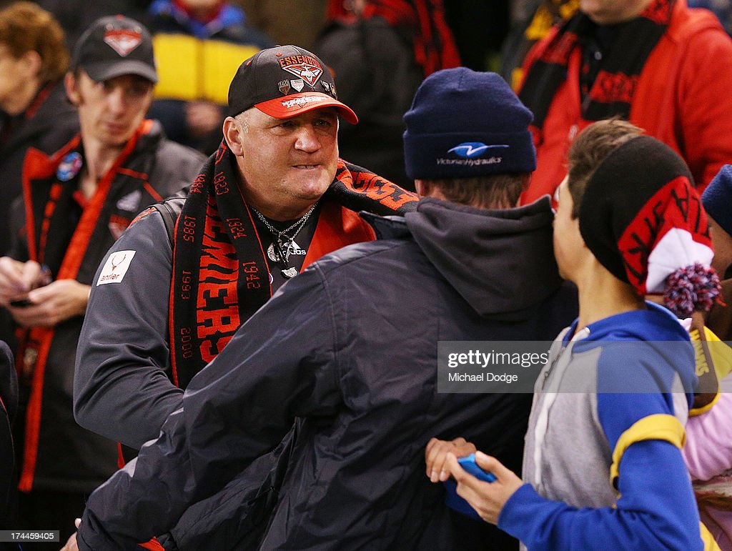An angry Bomber and Hawk supporter face off after the round 18 AFL match between the Essendon Bombers and the Hawthorn Hawks at Etihad Stadium on July 26, 2013 in Melbourne, Australia.