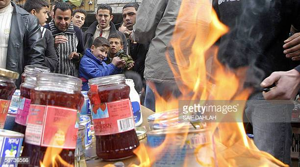An angry crowd of Muslim worshippers set ablaze 03 February 2006 Danish products in the West Bank town of Jenin during a demonstration against the...