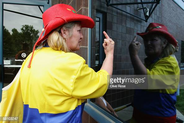 An angry fan vents her feelings at the circuit ticket office during the United States F1 Grand Prix at the Indianapolis Motor Speedway on June 19...