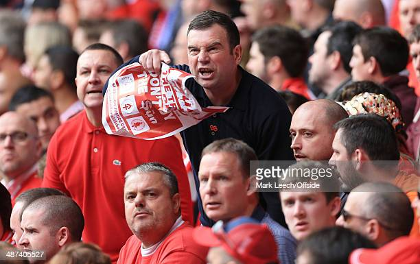 An angry Liverpool fan reacts to taunts from the visiting supporters during the Barclays Premier League match between Liverpool and Chelsea at...