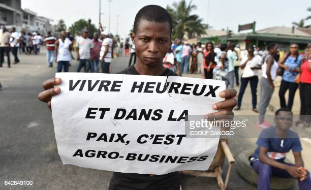 An angry subscriber who invested in agribusiness companies takes part in a demonstration on February 18 2017 in Abidjan after justice froze the...