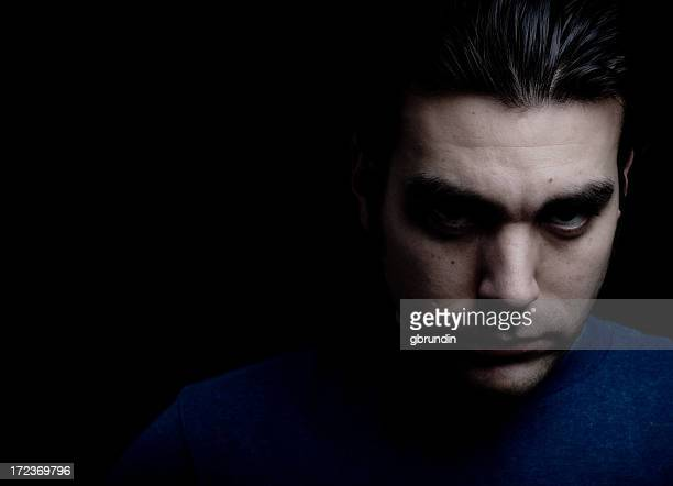 An angsty portrait of a man with dark thoughts