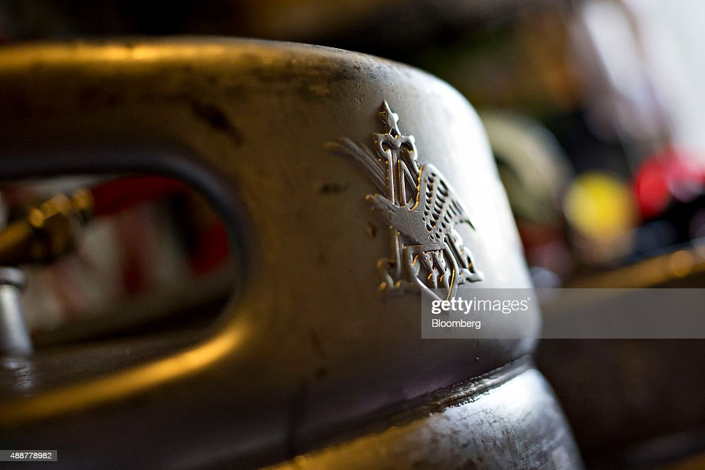 An AnheuserBusch InBev NV logo appears on the side of a half keg in the cooler of a bar in Chillicothe Illinois US on Thursday Sept 17 2015...