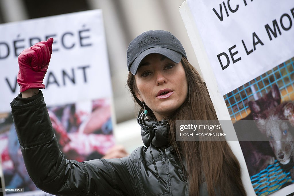 An animal rights activist holds a placard in front of the Opera on January 12, 2013 in Paris, to protest against cruelty towards animals and the use of fur in the fashion industry, during a nationwide anti-fur demonstration called by French association 'Fourrure Torture' (Fur Torture).