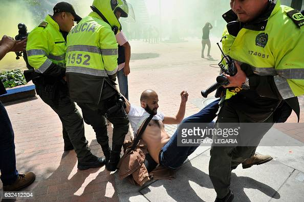 TOPSHOT An animal rights activist is arrested during a protest against bullfighting outside the Santamaria bullring in downtown Bogota Colombia on...