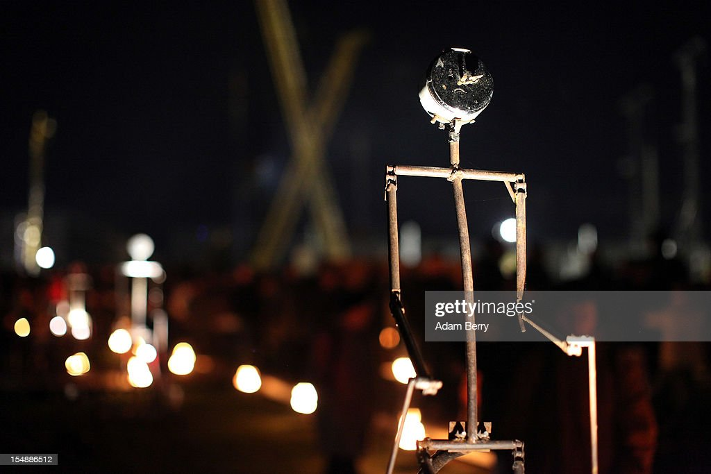 An animated car battery-powered mechanical stick figure operates during a presentation by the French fire performers Carabosse as part of celebrations marking the 775th anniversary of the city of Berlin on October 28, 2012 in Berlin, Germany. The settlement of Coelln, which stood opposite Berlin on the Spree river, is first referred to in a document from 1237, and by the beginning of the 14th century Coelln and Berlin joined together to become the region's most important trading center.