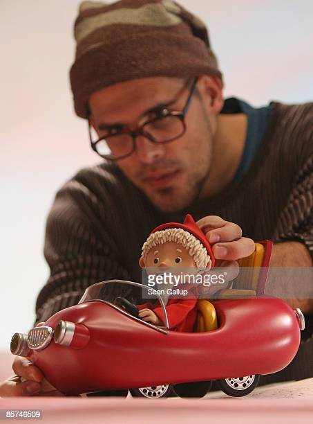 An animation crew member adjusts a Sandmaennchen figure on a film set at the Babelsberg film studios on April 1 2009 in Potsdam Germany German...