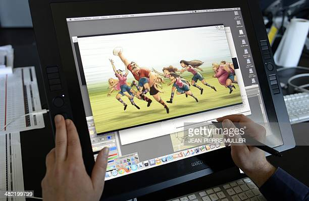 An animator works on the animation film 'Les demoiselles d'Ovalie' in the 'Prima Linea' studio in Angouleme central France on March 17 2014 Already...
