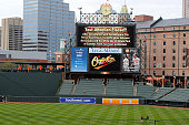 An announcement on the scoreboard notifies fans that the game between the Baltimore Orioles and the Chicago White Sox has been postponed at Oriole...