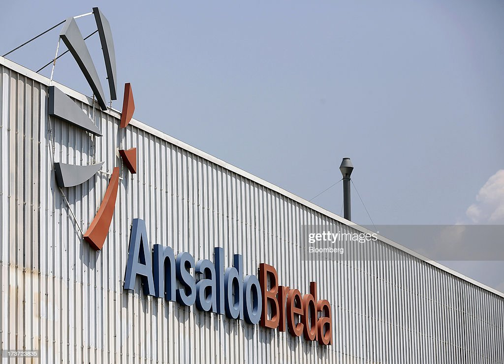 An AnsaldoBreda SpA logo sits outside the company's rail-car plant in Pistoia, Italy, on Tuesday, July 16, 2013. Italian business confidence rose last month after Prime Minister Enrico Letta's Cabinet passed plans to boost employment and postponed the payment of the value-added tax planned for July. Photographer: Alessia Pierdomenico/Bloomberg via Getty Images